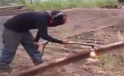 Rail Fail ….. Man Cutting Railway Track Gets Slammed