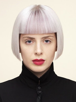 short helmet shape haircut with a silver color