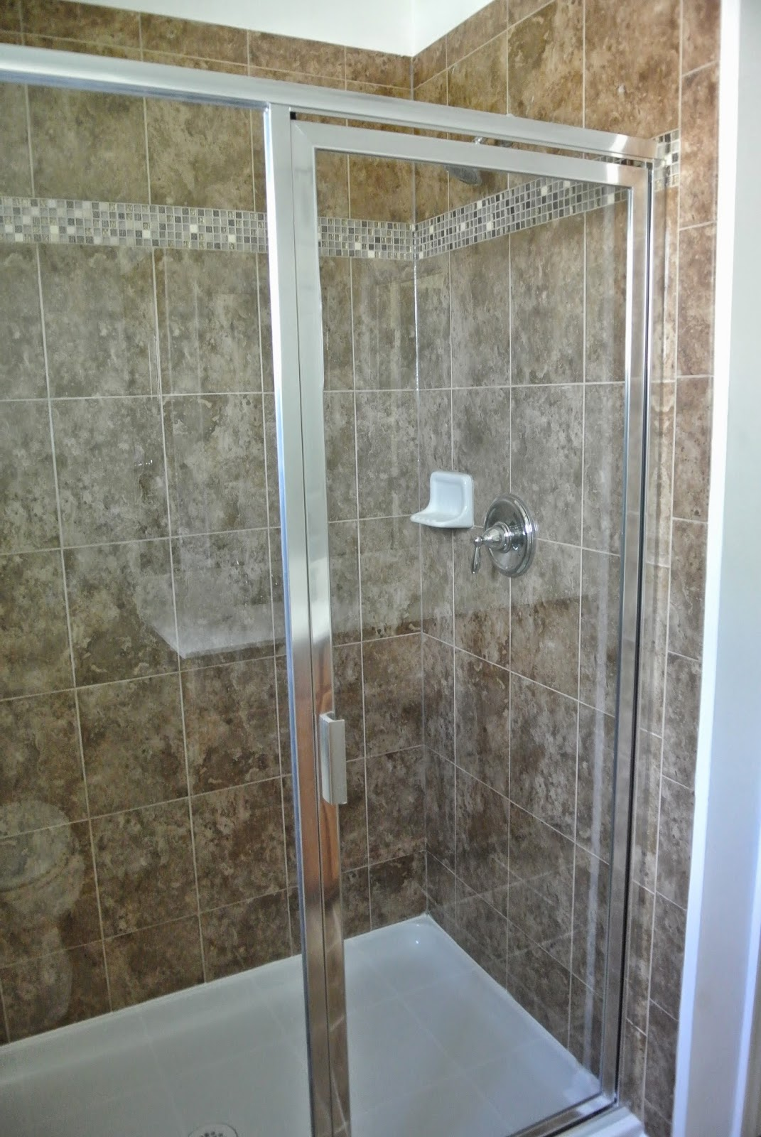 A picture of the installed shower door