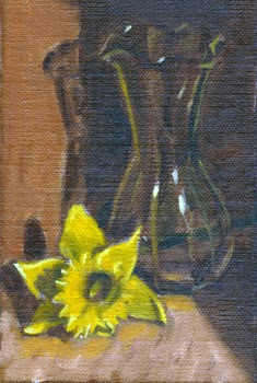 Oil painting of a yellow daffodil lying beside a glass vase.