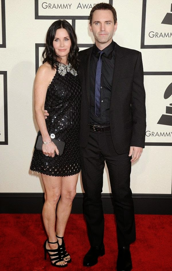 Courtney Cox kept things simple in a dark short dress with backless detail as she attended the Grammy Awards with fiance, Johnny McDaid at Los Angeles on Sunday, February 8, 2015.