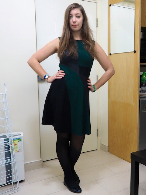 Emerald & Jade | outfit of green, black and grey geometric design smart dress, with black tights & flat shoes