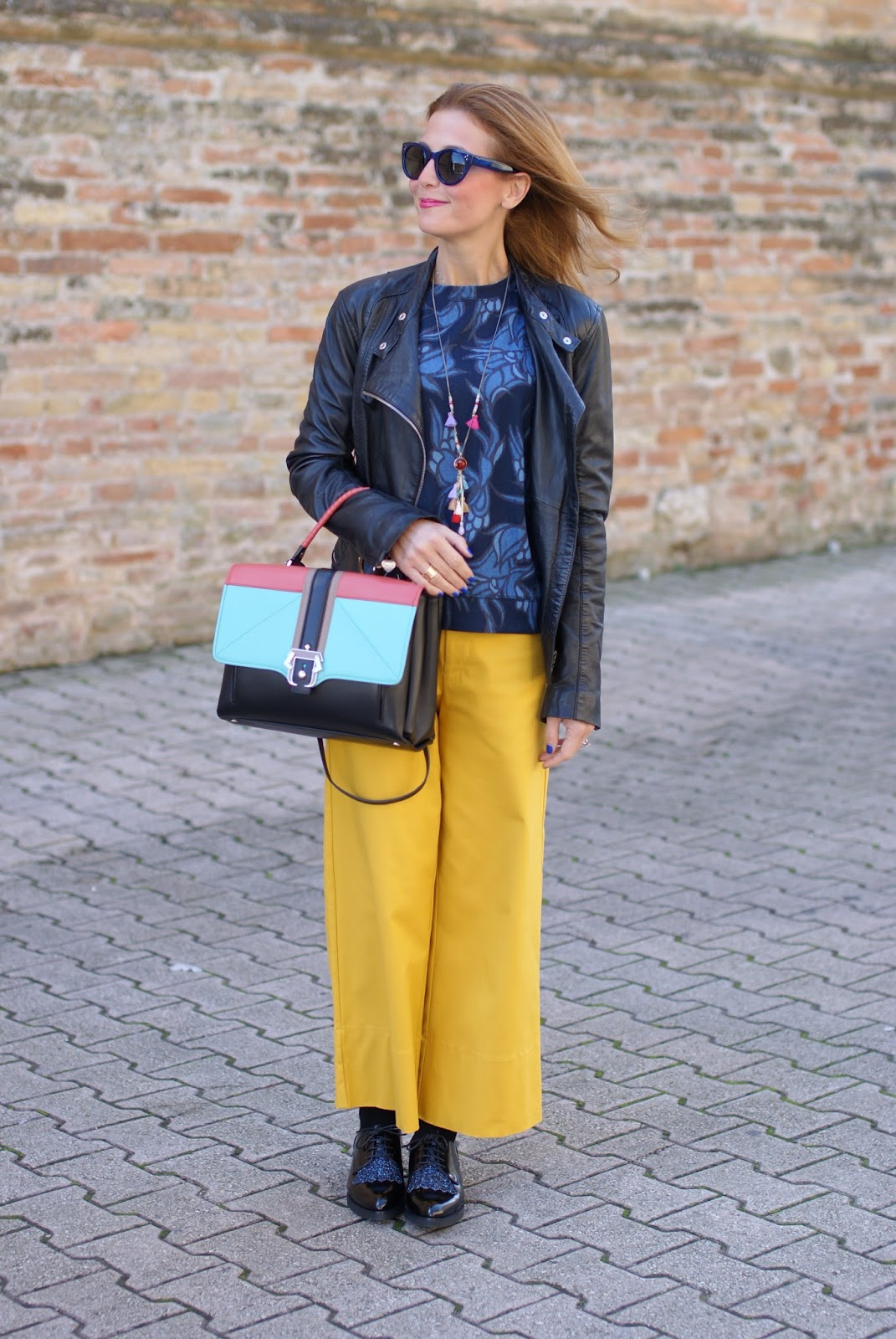 Paula Cademartori Faye color block handbag, yellow culottes and glitter lace-ups on Fashion and Cookies fashion blog, fashion blogger style
