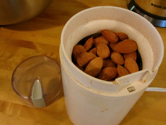 whole almonds in a coffee grinder