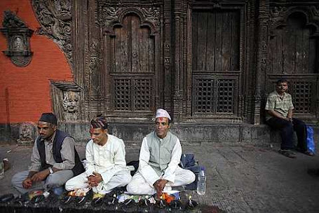 Hindu priests wait for devotees