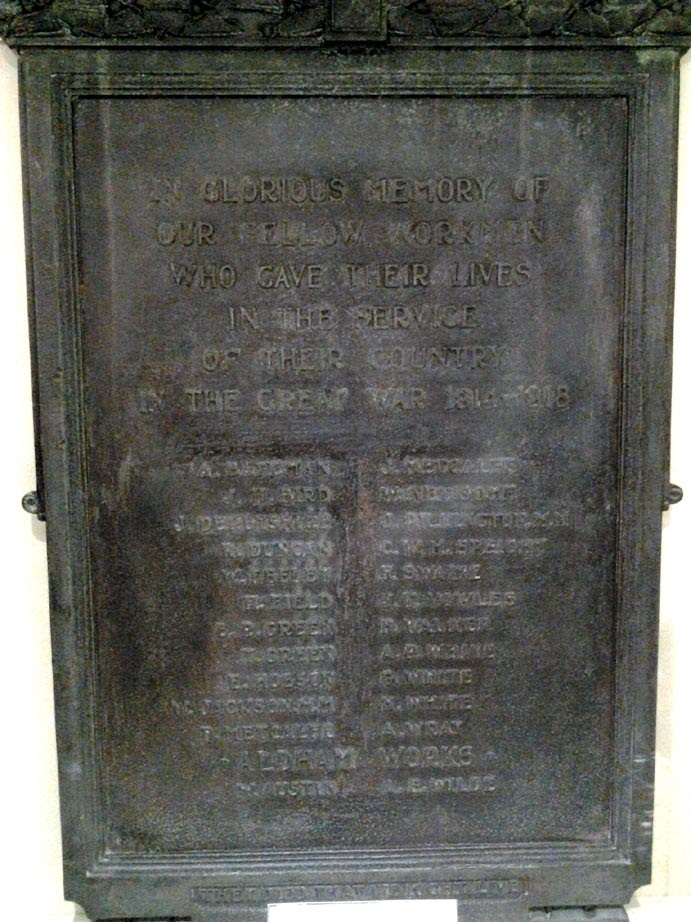 A dark bronze portrait shaped tablet, it is hard to make out the names, but there is a list on the Barnsley War Memorials Project site linked alongside.
