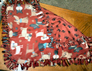 Shades of Safhire:  Dog-themed fleece blanket. Sized for as pet or baby.