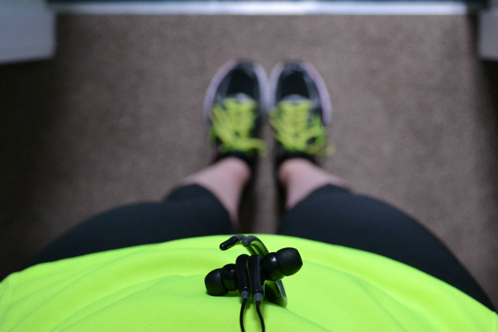 running gear clothes bright headphones trainers