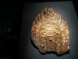 Golden head ornament