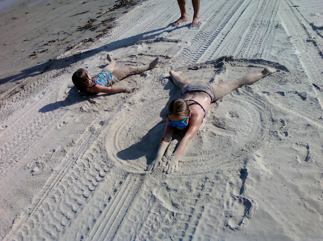 sand angels on the beach