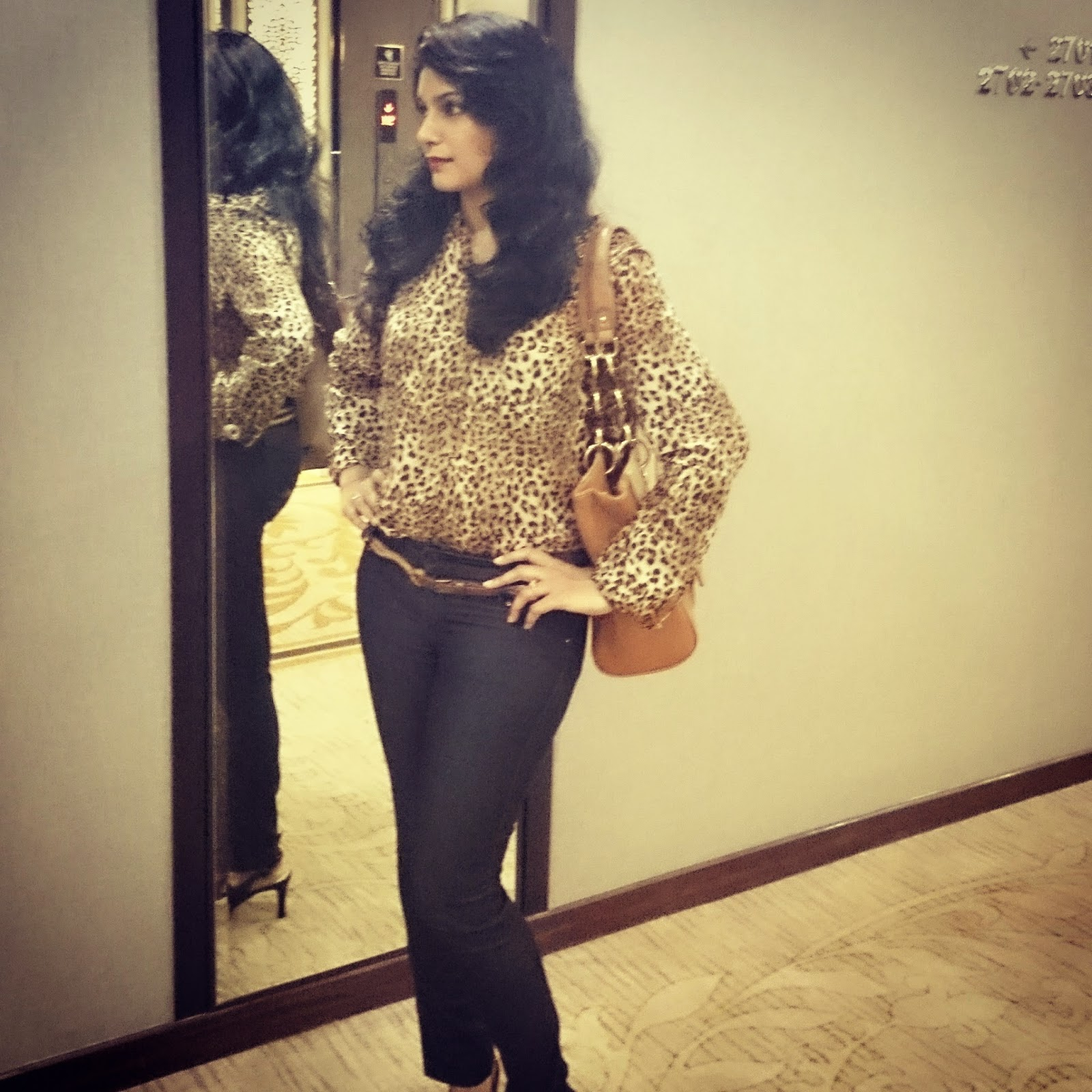 Khoobsurat Moment with leopard print, red lips and wavy hair.