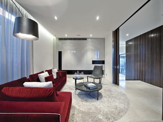 Photo of living room with red sofa in amazing dream home in Melbourne