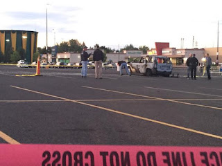 http://www.khq.com/story/29374786/car-explodes-with-person-inside-in-walmart-parking-lot