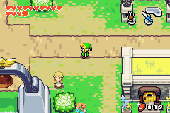 Screenshot of Game Boy Advance title The Legend of Zelda: The Minish Cap. Link is standing in a town.