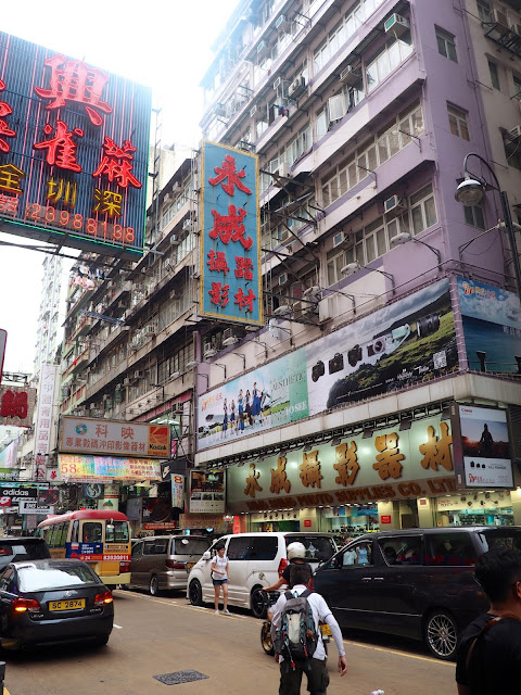 Signs, skyscrapers & traffic in the streets of Mong Kok, Kowloon, Hong Kong