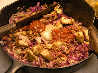 chicken and cabbage in a skillet