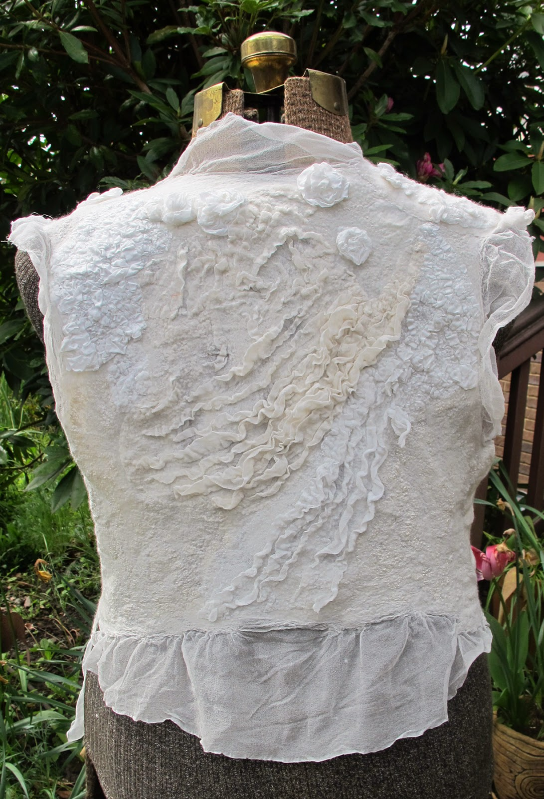 Pat Spark white felt vest from the back