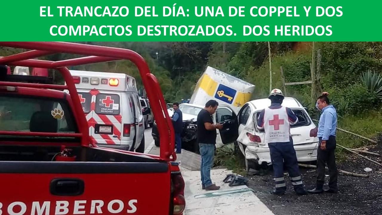 DOS COMPACTOS DESTROZADOS. DOS HERIDOS