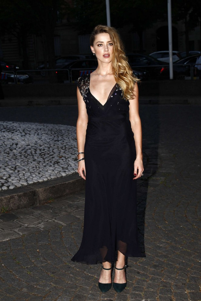 Amber Heard in a plunging dress at the Miu Miu Fragrance and Croisiere Collection 2016 launch in Paris