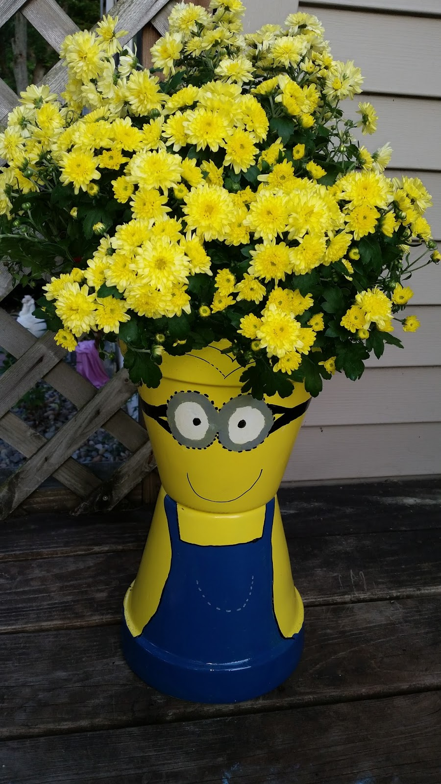 Flowers Made Out Of Tractor Parts : Diy minion flower pot planters mommy s block party