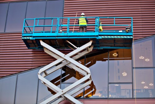 workers on scissor lift