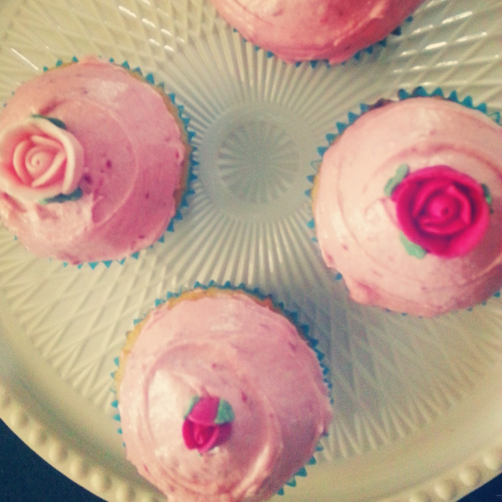 cupcakes with roses and pink icing