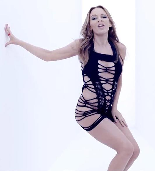 KYLIE MINOGUE in a sexy short dress timebomb vide photo
