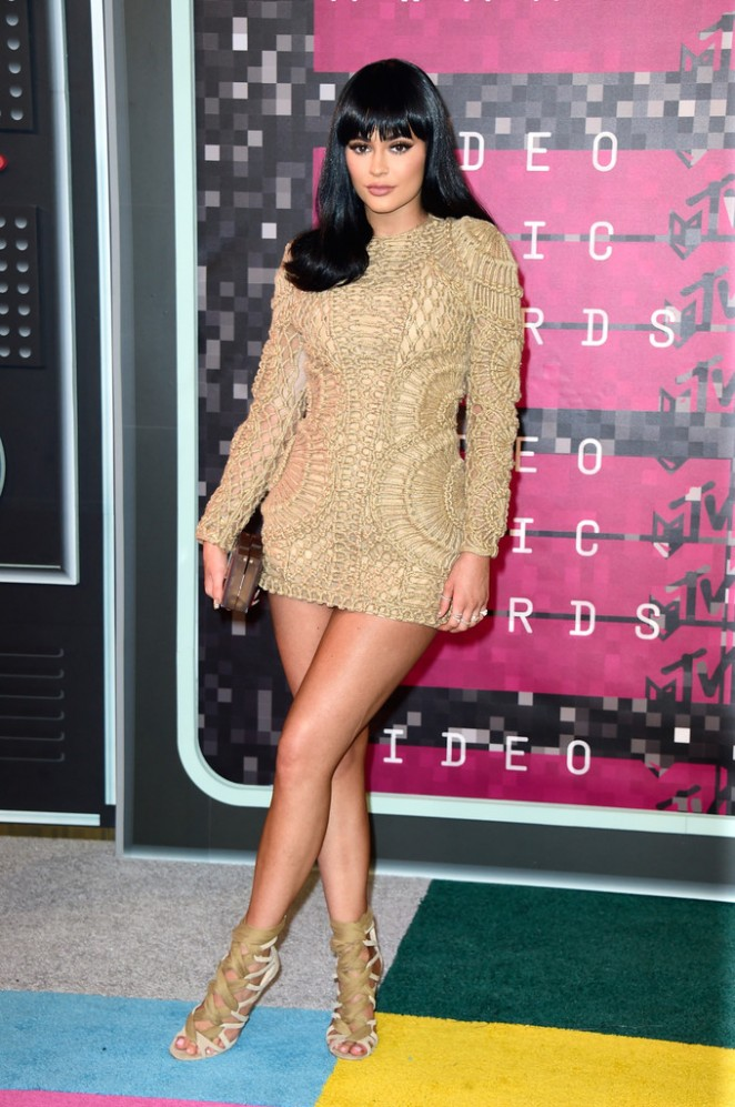 Kylie Jenner turning into a klone of Kim attends VMA's with boyfriend Tyga