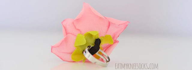 Born Pretty Store's floral rose ring features a 3D fabric rose on a silver ring.