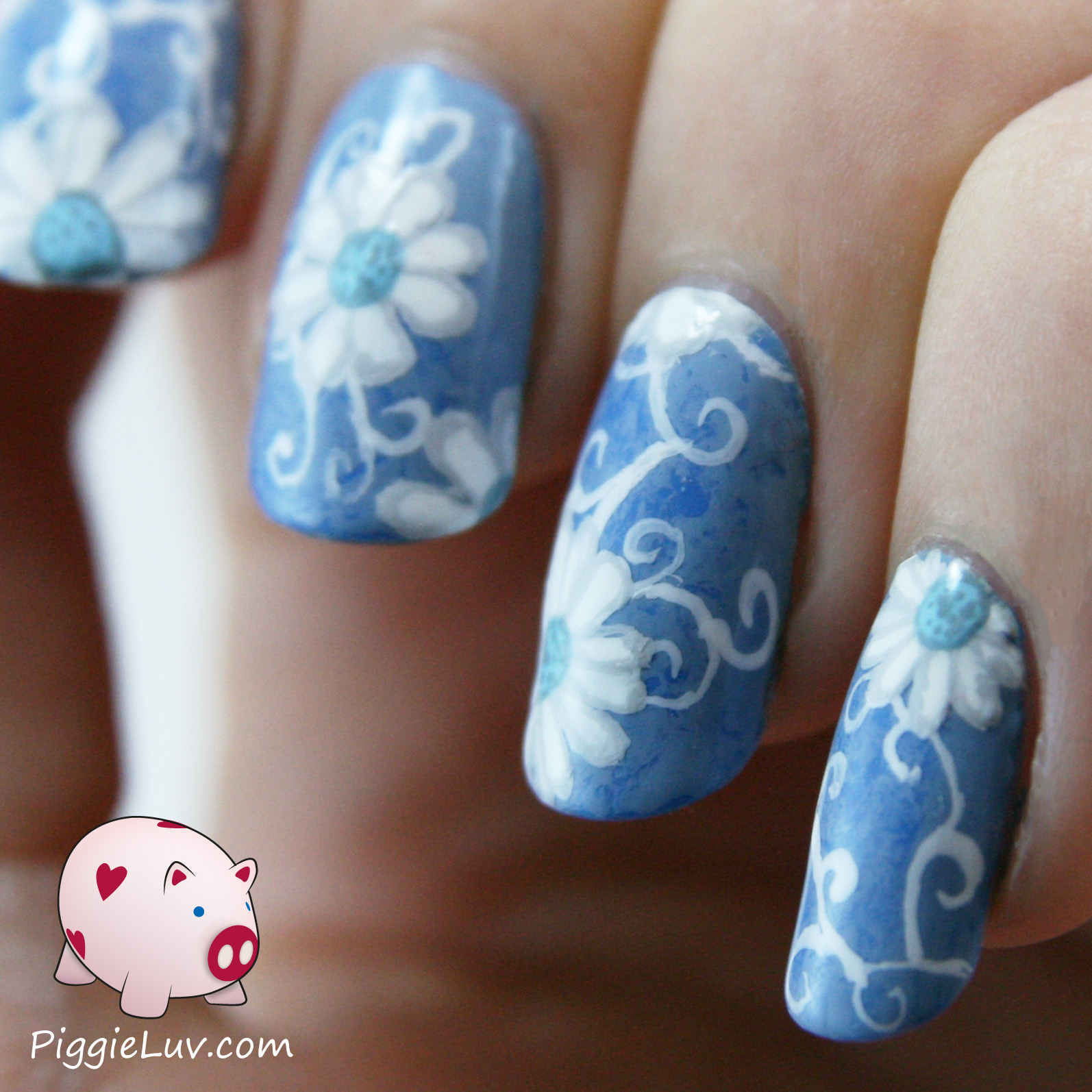 PiggieLuv: White daisies on blue nails for Autism