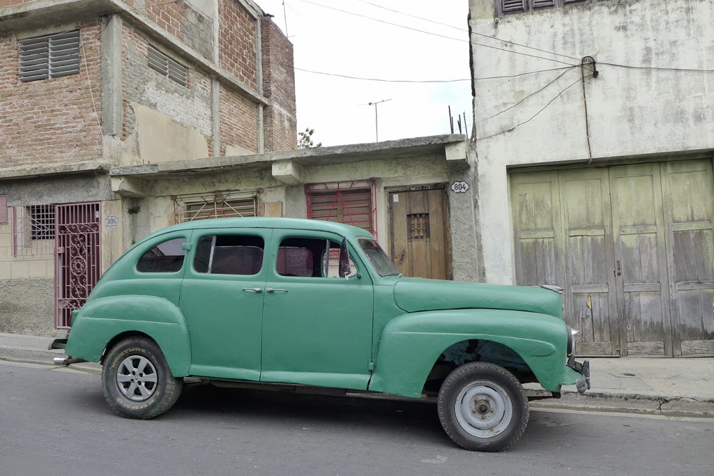 Santiago de Cuba vintage car light green