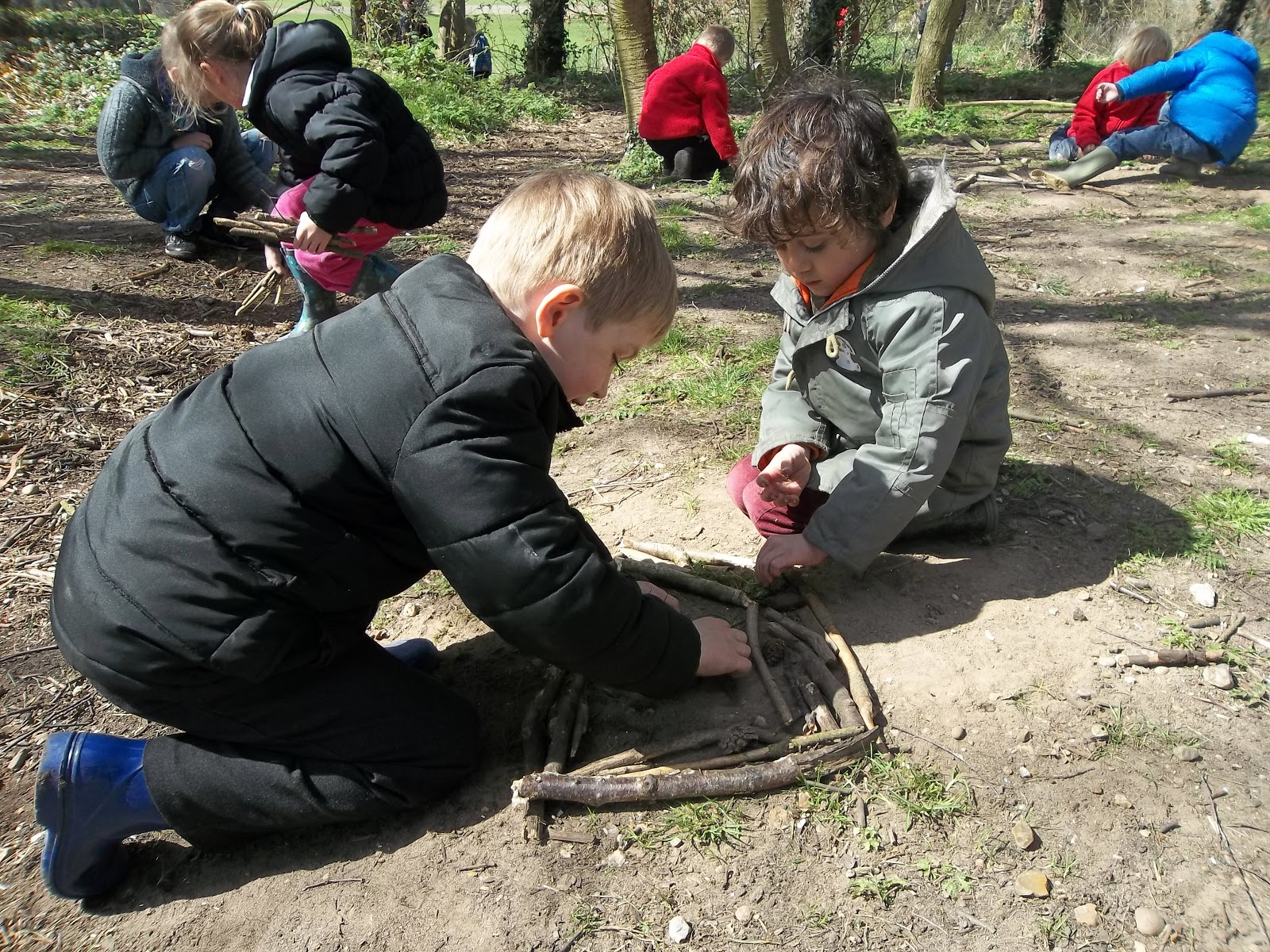 Gresham village school and nursery making nests in forest schools