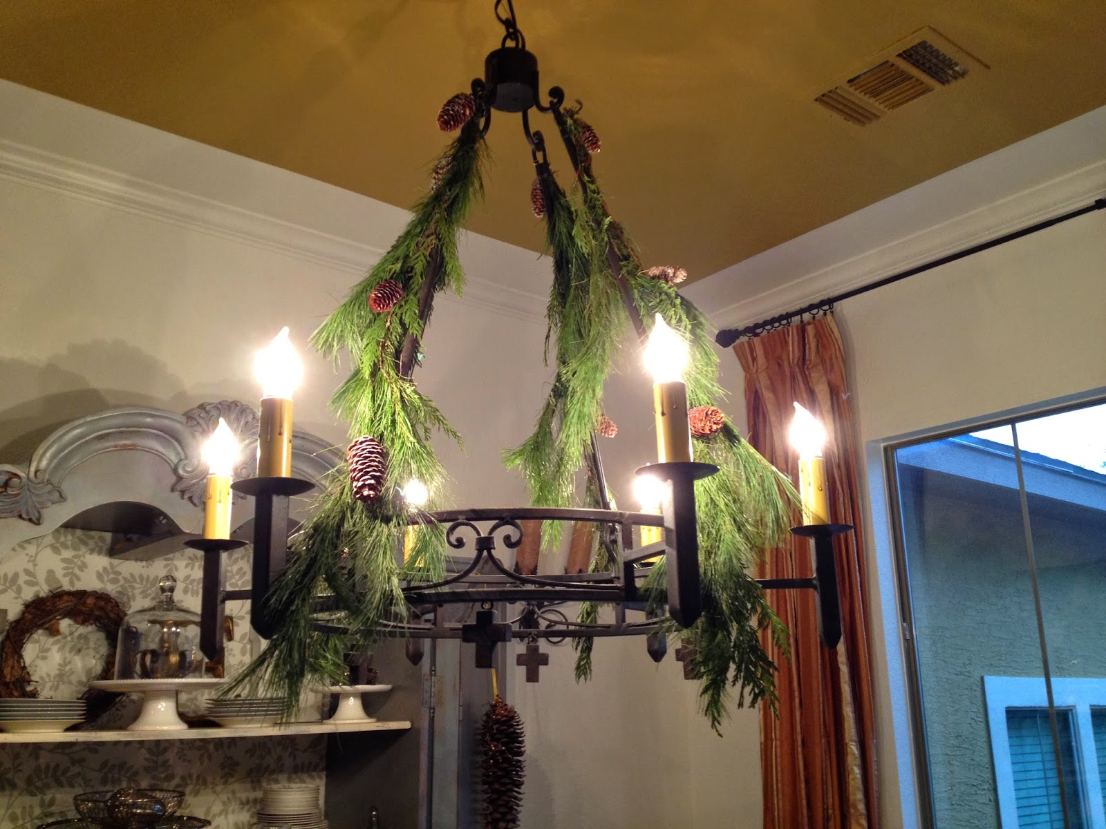 greenery around a chandelier