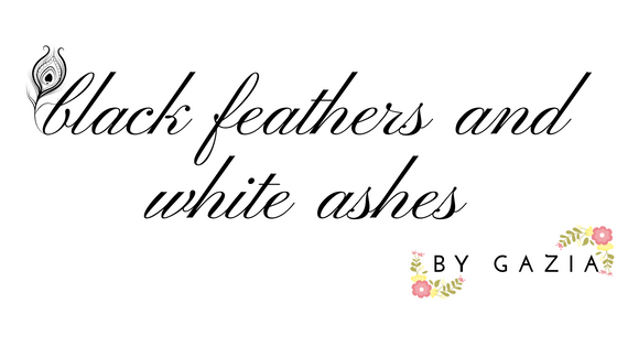 black feathers and white ashes