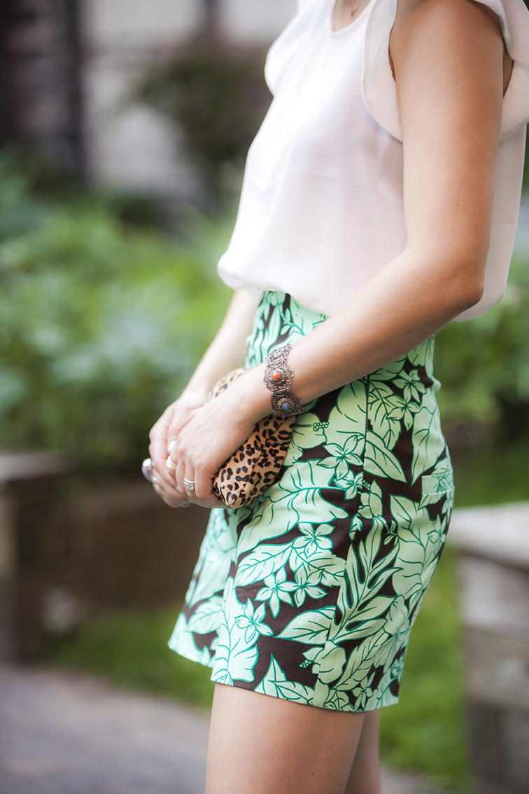 White silk blouse, leopard print calf hair J.Crew pouch, vintage bracelet, Zara tropical print high waisted shorts