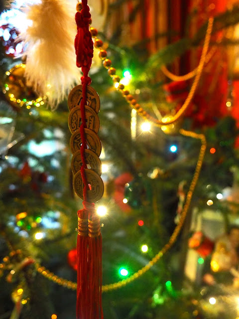 Lucky Chinese coins on a red tassel - Christmas tree decoration brought back from Hong Kong