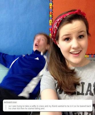 guy falls in girl's selfie, selfie at school, funny selfies, photobomb funny, photobomb fail, photobomb guy fall out of chair