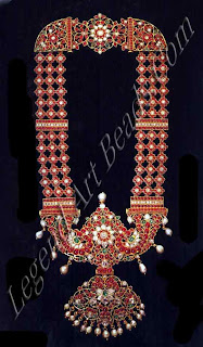 Gold necklace set with rubies, diamonds, emeralds and pendant pearls; the reverse of the pendant is engraved and inscribed with the name of the former owner.