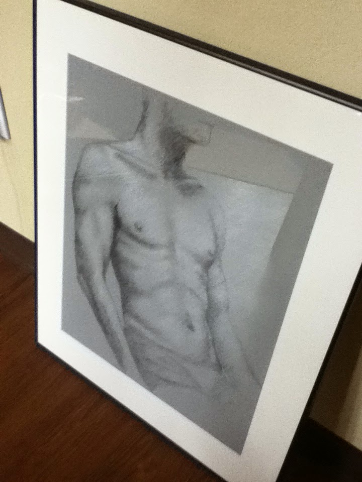A picture of my framed drawing of a male torso.