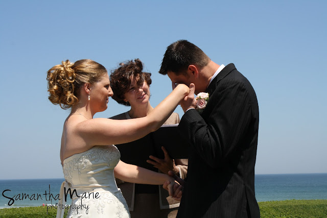 groom wiping away a tear during the ceremony