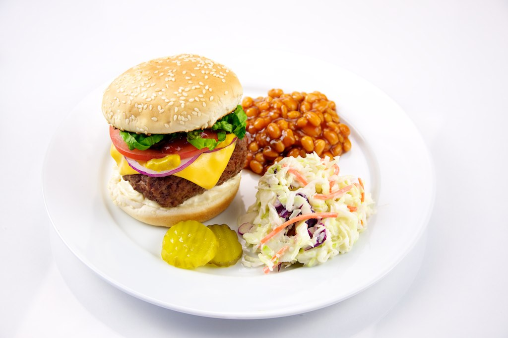 A burger, beans and coleslaw