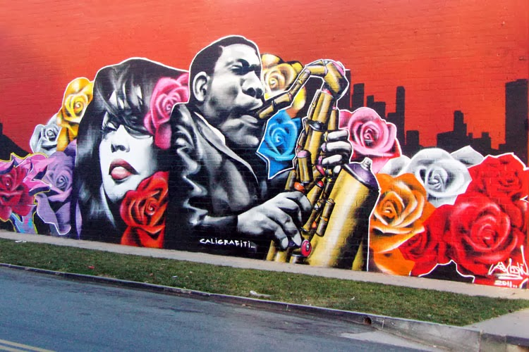mural of man playing paint-can saxophone