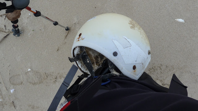 helmet found on beach attached to pack