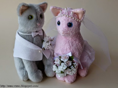 Gray cat and pink cat