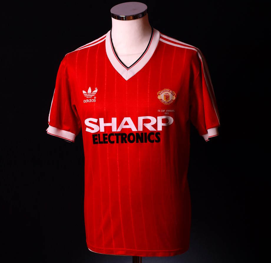 Adidas manchester united home kit history footy headlines for Manchester united shirt sponsor