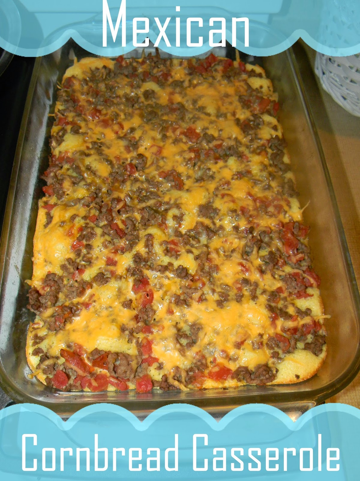 Spread ground beef mix over corn bread in dish top with cheese bake