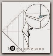 Bước 8: Gấp cạnh giấy vào trong giữa hai lớp giấy.