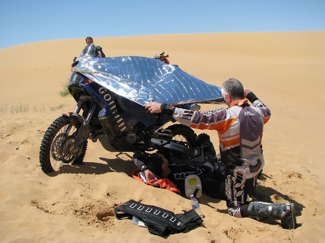 Kevin, soldiering his 950 in Altar.  A sink hole broke his shoulder.  He had to ride out...5 hours.