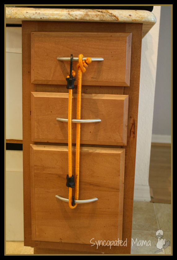 Exceptional How To Baby Proof Kitchen Cabinets #4: How To Baby-Proof With Bungee Cords