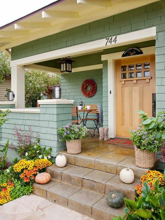 sage-green-house-with-wooden-door